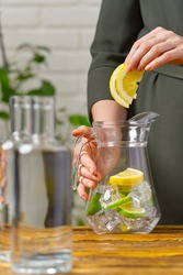 healthy eating, drinks, diet, detox concept close up of woman with fruit infused water in glass jag
