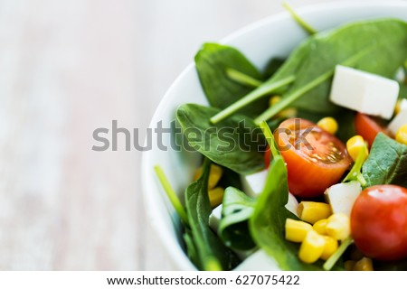 healthy eating, food, dieting and vegetarian concept - close up of vegetable salad in bowl