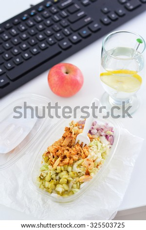 Healthy eating for lunch to work. Food in the office. Chicken salad.