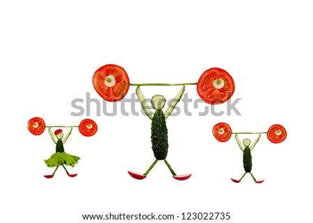 Healthy eating. Funny little people of the cucumber slices raises tomato bar.