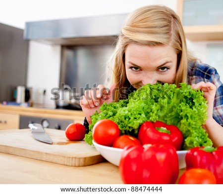Healthy eating girl making a fresh vegetable salad