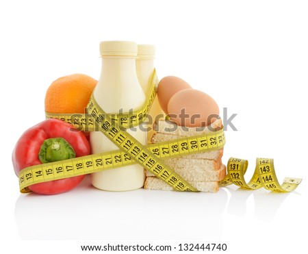 Healthy eating or dieting concept. Food wrapped in measuring tape.