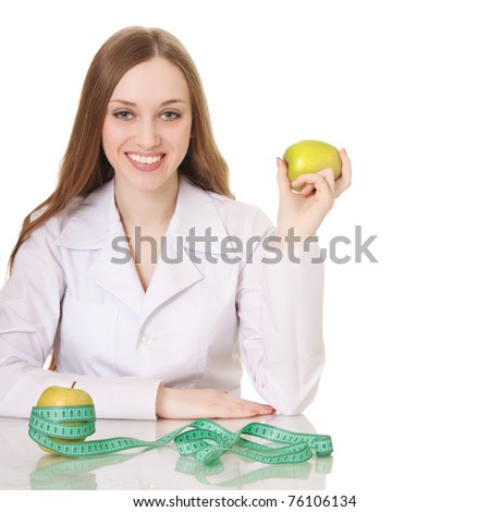 Healthy eating or lifestyle concept. woman doctor with a green apple.
