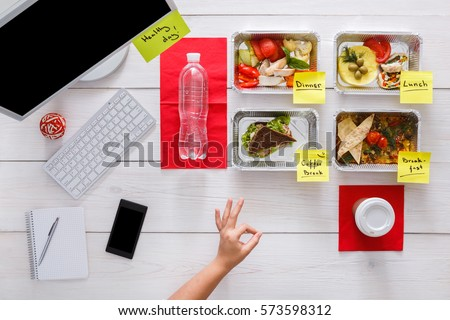 Healthy eating. Restaurant food delivery, business lunch and diet plan, fresh daily meals with stickers in office at workplace. Vegetables, meat and fruits in foil boxes. Top view, flat lay on wood #573598312