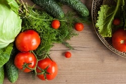 Healthy eating. The concept of healthy food, fresh vegetables on a wooden background. View from above. Copy space.