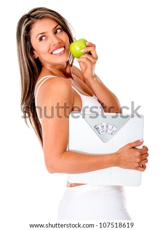 Healthy eating woman trying to lose weight - isolated over a white background