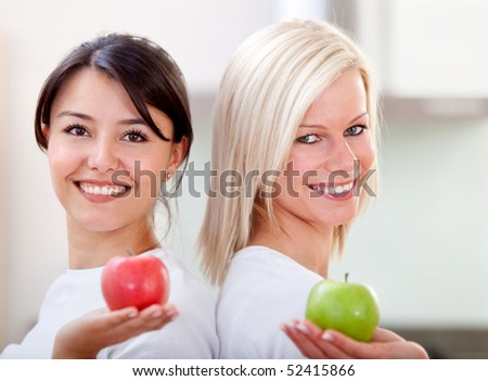 Healthy eating women holding apples and smiling - stock photo