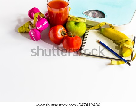 Healthy eating ,Workout and fitness dieting ,fitness and weight loss concept, tape measure, banana, apple, tometo juice ,fruit , blank copy space notebook,white background