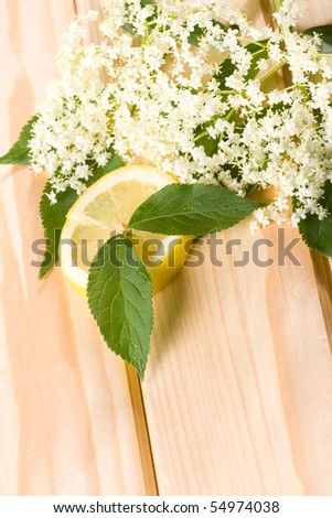 Healthy elder flowerwith lemon on wooden background.