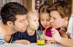 Healthy family drinking fresh orange juice