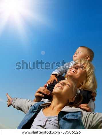 Healthy Family Outdoor.Happy Mother with Kids over blue sky