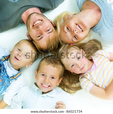Healthy Family. Parents with three kids having fun together