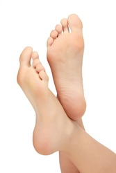 Healthy female feet, white background, copyspace