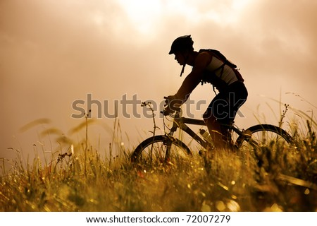 healthy fit man rides his mountainbike outdoors, carefree bicycle fitness