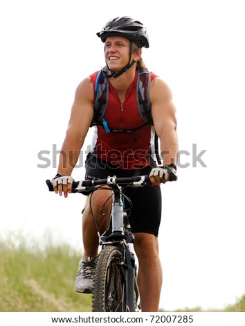 healthy fit man rides his mountainbike outdoors, carefree bicycle fitness - stock photo