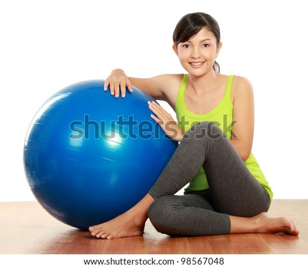 healthy fitness woman relaxing with pilates ball