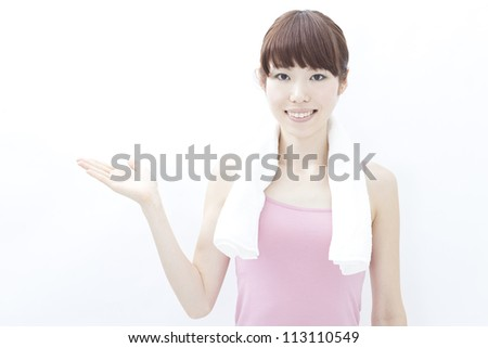 Healthy fitness woman showing copy space