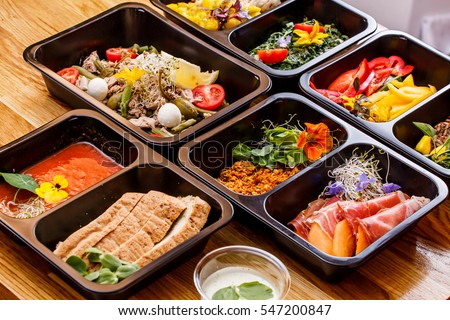 Healthy food and diet concept, restaurant dish delivery. Take away of fitness meal. Weight loss nutrition in foil boxes.  Сток-фото ©