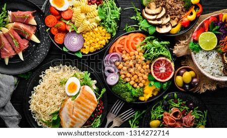 Healthy food. Assortment of the Buddha Bowl on a black background. Top view. Free space for your text. #1314272714