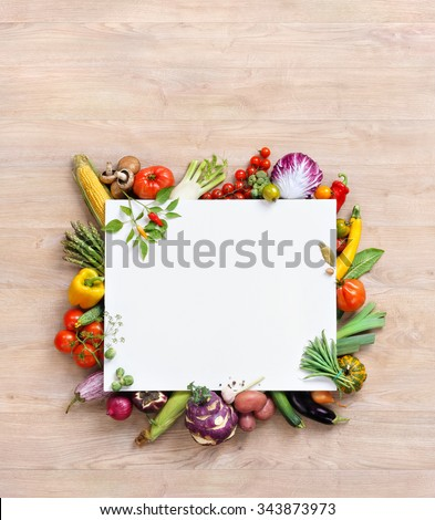 Healthy food background and Copy space / studio photography of white paper surrounded by fresh vegetables on old wooden table. Healthy food background, top view. High resolution product,
