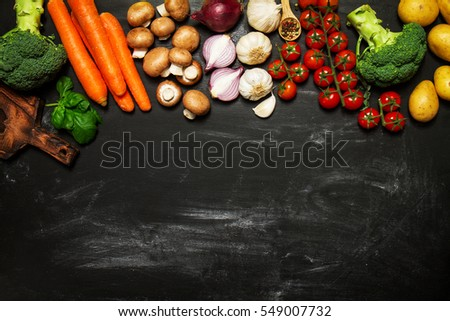 Healthy food background. Healthy food concept with fresh vegetables and ingredients for cooking. Top view with copy space. Dark background. #549007732