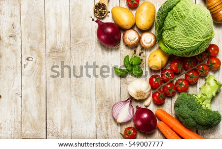 Healthy food background. Healthy food concept with fresh vegetables and ingredients for cooking. Top view with copy space. Wooden background.