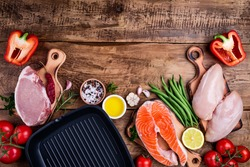 Healthy food background. Meat, fish, vegetables,pan for cooking grill. Healthy eating concept. Top view, copy space