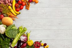 Healthy food background / studio photo of different fruits and vegetables on wooden table