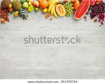 Healthy food background. Studio photo of different fruits on white wooden table. High resolution product. #391490764