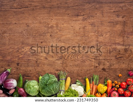 Healthy food background / studio photography of different fruits and vegetables on old wooden table