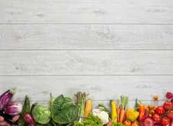Healthy food background / studio photography of different fruits and vegetables on wooden table
