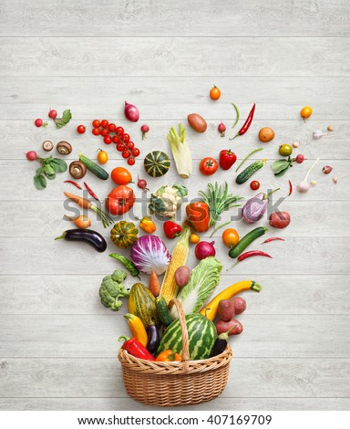 Healthy food background. Studio photography of different vegetables on white wooden table. Top view, high-res product.