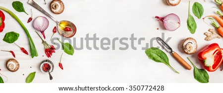 Healthy food background with various vegetables ingredients, spoon with oil and peeler, top view #350772428