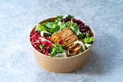 Healthy Food Bowl with Pomegranate, Chicken, Mexican Kidney Beans and Salad in Plastic Bowl Container.
