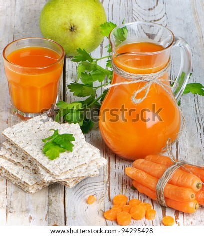 Healthy food - carrots, crispbreads and carrots juice