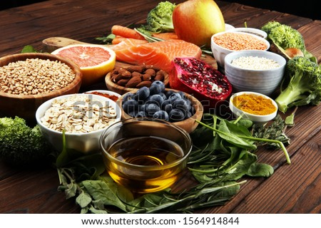 Healthy food clean eating selection: fish, fruit, vegetable, cereal, leaf vegetable on background Foto stock ©