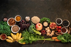 Healthy food clean eating selection: fish,fruit, vegetable, seeds, superfood, cereals, leaf vegetable on old kitchen table background copy space. Healthy food for humans. Background  with for text