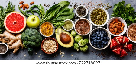 Healthy food clean eating selection: fruit, vegetable, seeds, superfood, cereal, leaf vegetable on gray concrete background #722718097