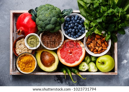 Healthy food clean eating selection in wooden box: fruit, vegetable, seeds, superfood, cereals, leaf vegetable on gray concrete background - Shutterstock ID 1023731794