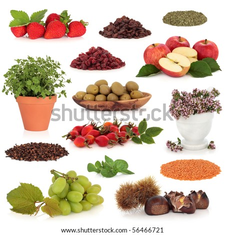Healthy food collection of fruit, nuts, herbs and pulses, very high in antioxidants and vitamins, isolated over white background.