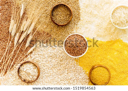 Healthy food concept. Cereals in bowls on cereals background top view #1519854563