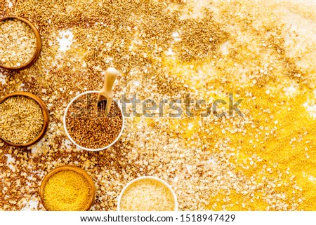 Healthy food concept. Cereals in bowls on cereals background top view frame copy space #1518947429