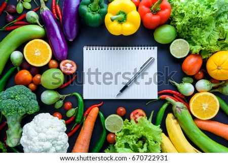 Healthy food concept of fresh organic vegetables and wooden desk background. Ingredients top view #670722931