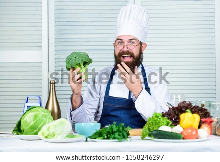 Healthy food cooking. Bearded man cook in kitchen, culinary. Chef man in hat. Secret taste recipe. Dieting and organic food, vitamin. Vegetarian. Mature chef with beard. Pictures of food.