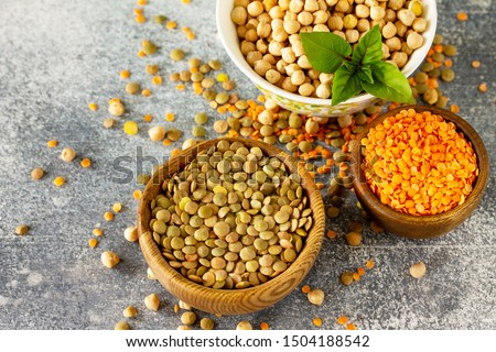 Healthy food, dieting, concept vegan protein source. Raw of legumes (chickpeas, red lentils, canadian lentils). Free space for your text.