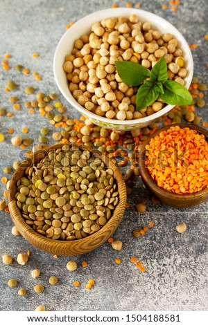 Healthy food, dieting, concept vegan protein source. Raw of legumes (chickpeas, red lentils, canadian lentils).