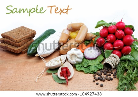 Healthy food. Fresh vegetables and fruits on a wooden table.