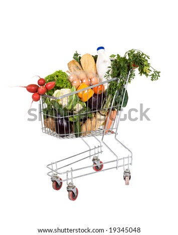 Healthy food - groceries in shopping cart - isolated