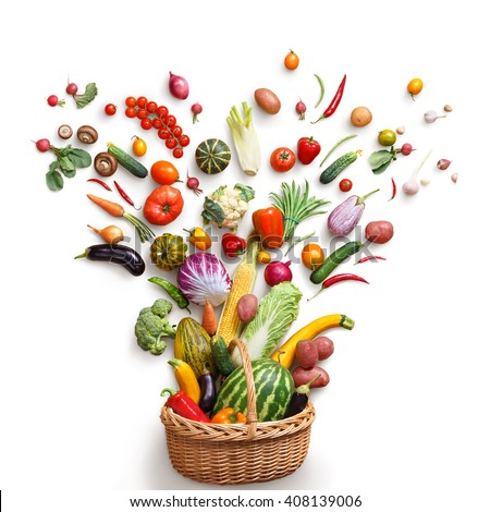 Healthy food in basket. Studio photography of different fruits and vegetables isoleted on white backdrop, top view. High resolution product.