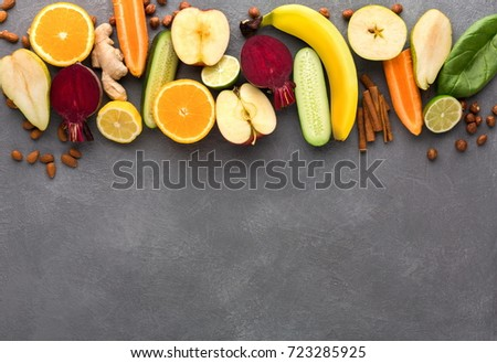 Healthy food. Ingredients for detox smoothie, vivid fruits and vegetables on gray background., top view, copy space. #723285925